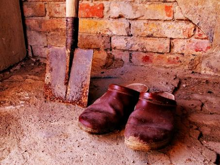 Free Stock Photo of Old shoes with shovel