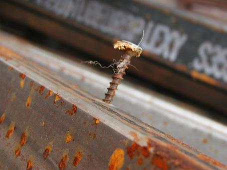 Free Stock Photo of Rusted screw in metal bar
