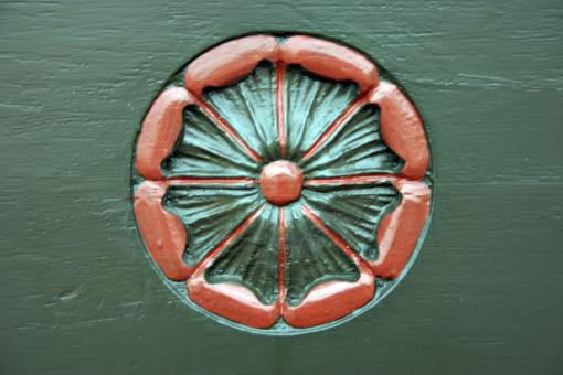 Free Stock Photo of Flowery icon carved into a church door