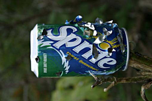 Free Stock Photo of Sprite can with bullet holes
