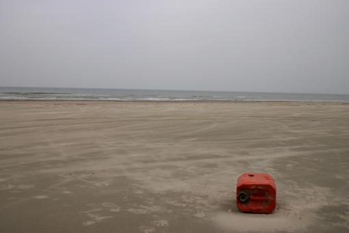 Free Stock Photo of Petrol tank on a beach