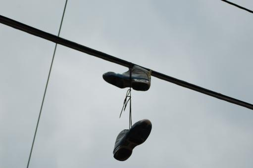 Free Stock Photo of Shoes on a Pylon