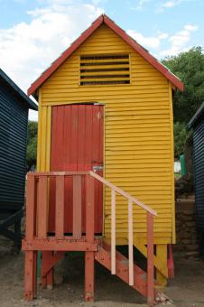 Free Stock Photo of Yellow cabin on the beach.