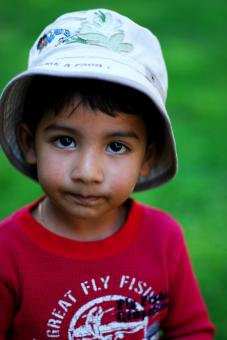 Free Stock Photo of Young boy with a hat