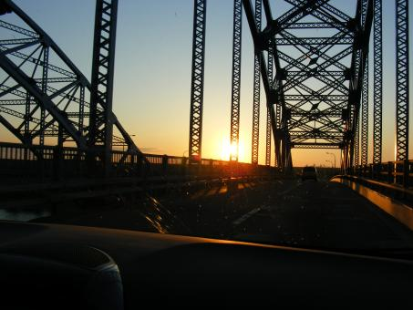 Free Stock Photo of Sun set through a bridge