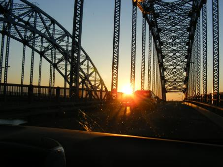 Free Stock Photo of Sunset through a bridge