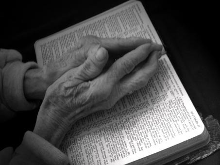 Free Stock Photo of Praying Hands on Bible - Black and White