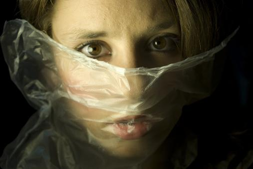 Free Stock Photo of Fear - Girl with Plastic Bag over Face