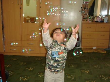 Free Stock Photo of Child chasing bubbles