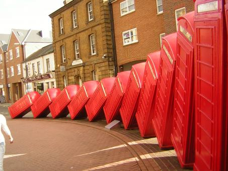 Free Stock Photo of Collapsing Telephone Boxes