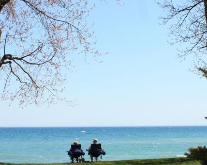 Free Stock Photo of Couple sitting at Lake Ontario, Oshawa