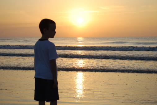 Free Stock Photo of Sunrise at beach with boy