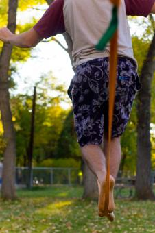 Free Stock Photo of Male Walking Slackline
