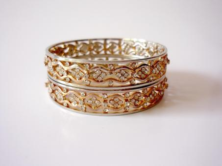 Free Stock Photo of Two Gold Bangles