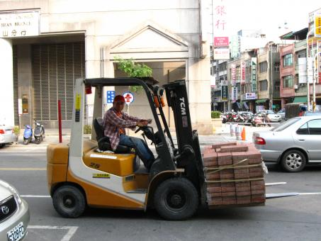 Free Stock Photo of Driving a Forklift