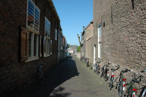 Free Stock Photo of Alley with parked bicycles
