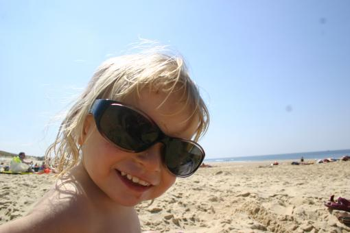Free Stock Photo of Little Girl with too big sunglasses on t
