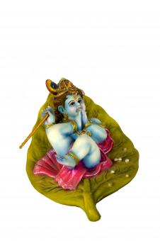 Free Stock Photo of Colorful clay idol of lord krishna