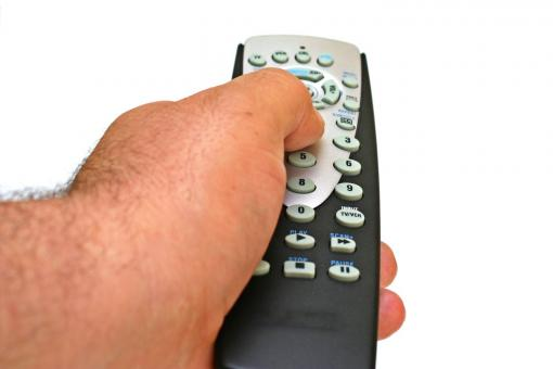 Free Stock Photo of remote control in hand isolated