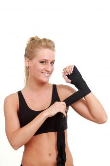 Free Stock Photo of Woman wrapping her hands for a wrestling