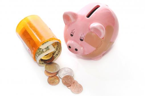 Free Stock Photo of Piggy bank with pill bottle