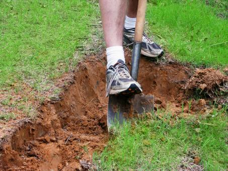Free Stock Photo of Man digging a hole