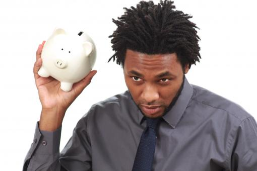 Free Stock Photo of Man with a piggy bank