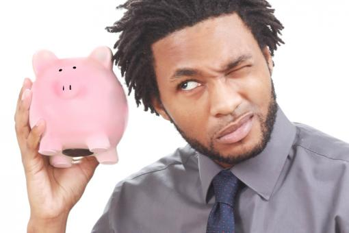 Free Stock Photo of Man shaking a piggy bank