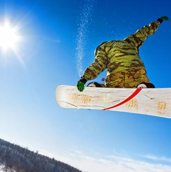 Free Stock Photo of Snowboarder jumping