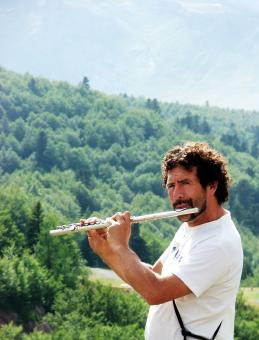 Free Stock Photo of Man playing the flute in the mountains