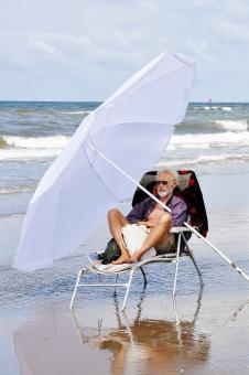Free Stock Photo of Man relaxing on beach