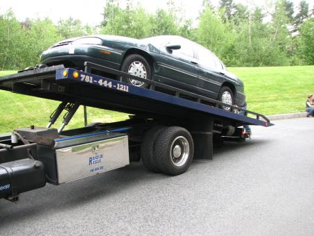 Free Stock Photo of Car on Tow Truck