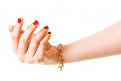 Free Stock Photo of Woman Hand with Gold Bracelet