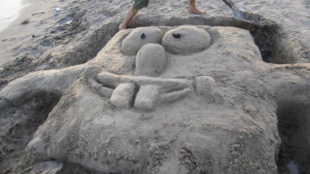Free Stock Photo of Sponge Bob out of the sand