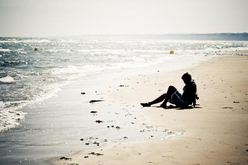 Free Stock Photo of Girl sitting on the beach