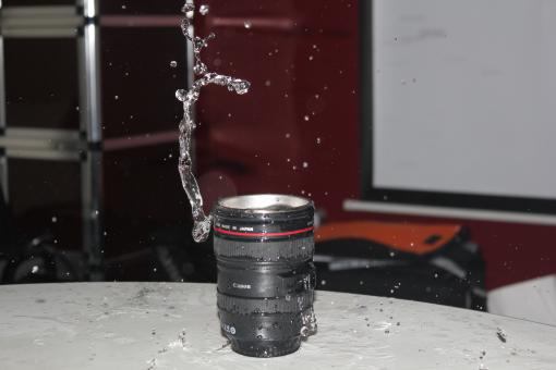 Free Stock Photo of  Canon camera lens with water