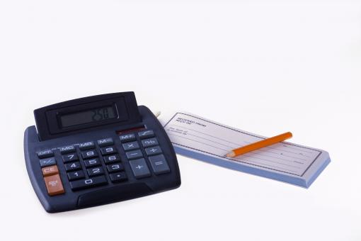 Free Stock Photo of Calculator and Receipt Book