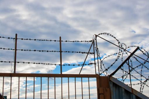 Free Stock Photo of Barbed wire fence