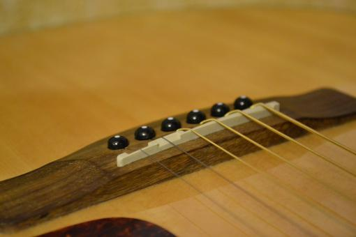 Free Stock Photo of Acoustic guitar bridge