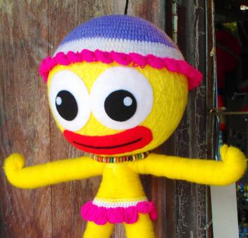 Free Stock Photo of Bright Yellow Kids Doll