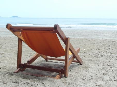 Free Stock Photo of Deckchair on an Empty Beach