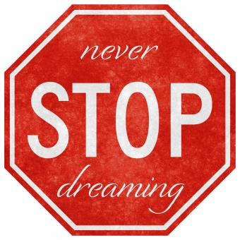 Free Stock Photo of Grunge Road Sign - Never Stop Dreaming