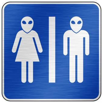 Free Stock Photo of Brushed Metal Sign - Alien Toilet