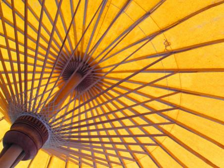 Free Stock Photo of Bright Orange Oriental Sun Umbrella