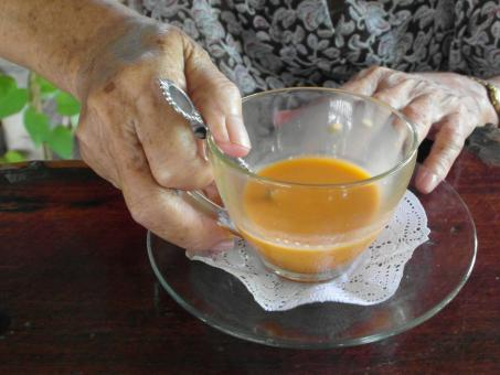 Free Stock Photo of Old Lady Holds Tea Cup