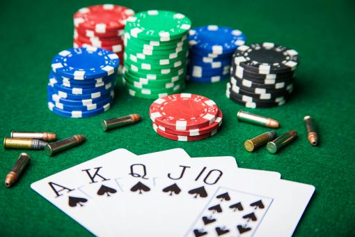 Free Stock Photo of Royal Flush with bullets and poker chips