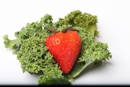 Free Stock Photo of Red Strawberry on kale