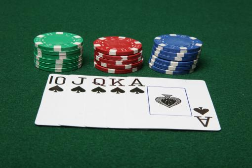 Free Stock Photo of Royal Flush with poker chips.