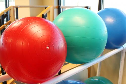Free Stock Photo of Red, Green and Blue Exercise Balls