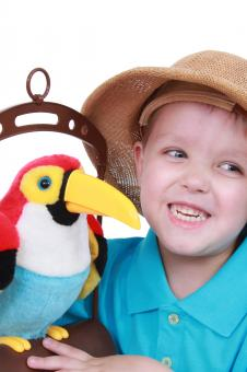 Free Stock Photo of Little boy talks to a bird
